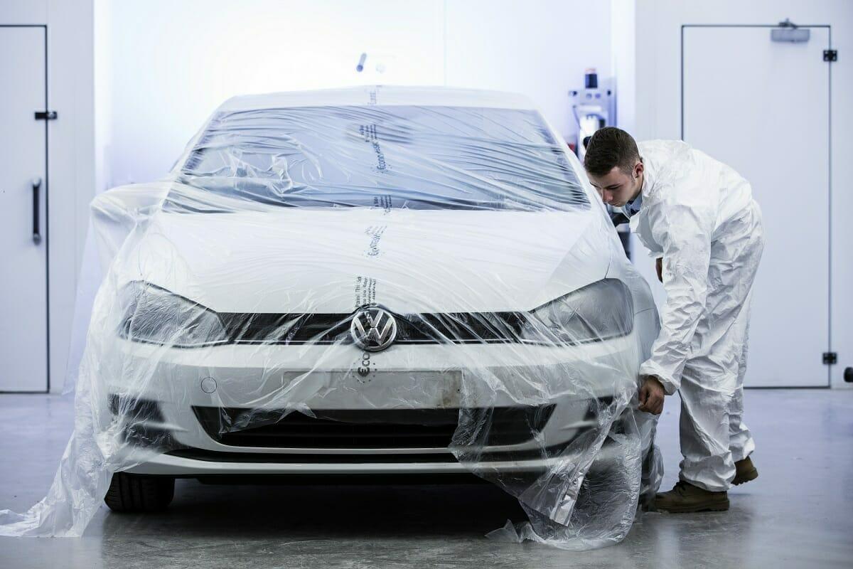 apprentice covering car pre paint